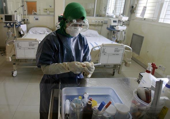 Jakarta. Chambre d'hôpital destinée aux personnes touchées par le H5N1. © Crack Palinggi - Reuters