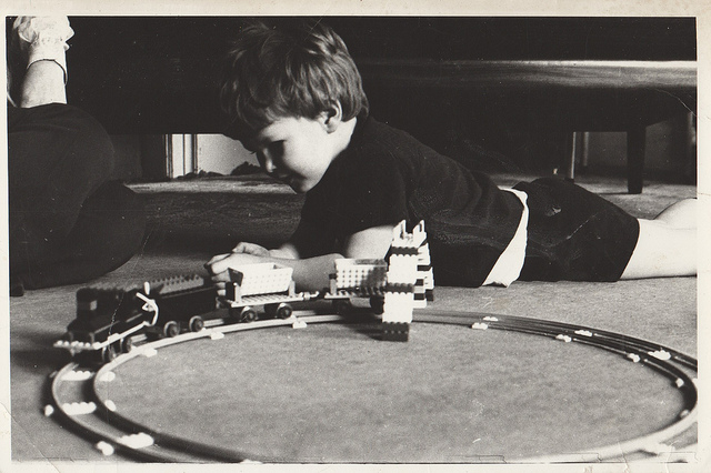 child playing with his lego train